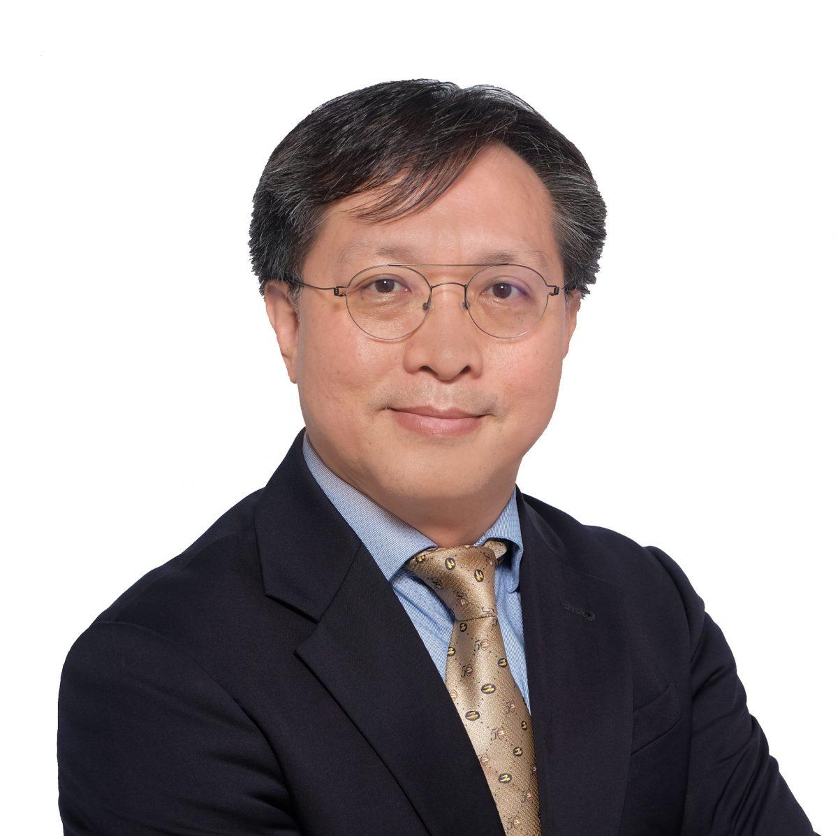 譚偉豪博士, JP